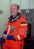 In the Operations and Checkout Building, STS-99 Mission Specialist Gerhard Thiele, who is with the European Space Agency, smiles as he dons his launch and entry suit during final launch preparations. Liftoff of STS-99, known as the Shuttle Radar Topography Mission (SRTM), is scheduled for 12:47 p.m. EST from Launch Pad 39A. The SRTM will chart a new course to produce unrivaled 3-D images of the Earth's surface, using two antennae and a 200-foot-long section of space station-derived mast protruding from the payload bay. The result of the Shuttle Radar Topography Mission could be close to 1 trillion measurements of the Earth's topography. Besides contributing to the production of better maps, these measurements could lead to improved water drainage modeling, more realistic flight simulators, better locations for cell phone towers, and enhanced navigation safety. The mission is expected to last about 11days. Endeavour is expected to land at KSC Friday, Feb. 11, at 4:55 p.m. EST
