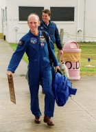 STS-99 Mission Specialist Gerhard Thiele (foreground) and Commander Kevin Kregel make their way to the runway at the Shuttle Landing Facility for a return flight to Houston. During the Jan. 31 launch countdown, Endeavour's enhanced master events controller (E-MEC) No. 2 failed a standard preflight test. Launch was postponed and Shuttle managers decided to replace the E-MEC located in the orbiter's aft compartment. Launch controllers will be in a position to begin the STS-99 countdown the morning of Feb. 6 and ready to support a launch midto late next week pending availability of the Eastern Range. The postponed launch gives the crew an opportunity for more training and time with their families. Known as the Shuttle Radar Topography Mission, it will chart a new course to produce unrivaled 3-D images of the Earth's surface, using two antennae and a 200-foot-long section of space station-derived mast protruding from the payload bay. The result could be close to 1 trillion measurements of the Earth's topography. Besides contributing to the production of better maps, these measurements could lead to improved water drainage modeling, more realistic flight simulators, better locations for cell phone towers, and enhanced navigation safety