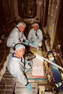 While checking out equipment during a Multi-Equipment Interface Test (MEIT) in the U.S. Lab Destiny, astronaut James Voss (center) and STS-98 crew members Commander Kenneth D. Cockrell (foreground) and Pilot Mark Polansky (right) pause for the camera. They are taking part in a Multi-Equipment Interface Test (MEIT) on this significant element of the International Space Station. Also participating in the MEIT is STS-98 Mission Specialist Thomas D. Jones (Ph.D.). Voss is assigned to mission STS-102 as part of the second crew to occupy the International Space Station. During the STS-98 mission, the crew will install the Lab on the station during a series of three space walks. The mission will provide the station with science research facilities and expand its power, life support and control capabilities. The U.S. Laboratory Module continues a long tradition of microgravity materials research, first conducted by Skylab and later Shuttle and Spacelab missions. Destiny is expected to be a major feature in future research, providing facilities for biotechnology, fluid physics, combustion, and life sciences research. The Lab is planned for launch aboard Space Shuttle Atlantis on the sixth ISS flight, currently targeted no earlier than Aug. 19, 2000
