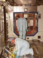 STS-98 Commander Kenneth D. Cockrell (left) and Mission Specialist Thomas D. Jones (Ph.D.) check out equipment in the U.S. Lab Destiny during a Multi-Equipment Interface Test. During the mission, Jones will help install the Lab on the International Space Station in a series of three space walks. The STS-98 mission will provide the station with science research facilities and expand its power, life support and control capabilities. The U.S. Laboratory Module continues a long tradition of microgravity materials research, first conducted by Skylab and later Shuttle and Spacelab missions. Destiny is expected to be a major feature in future research, providing facilities for biotechnology, fluid physics, combustion, and life sciences research. Others in the five-member crew on STS-98 are Pilot Mark L. Polansky, and Mission Specialists Robert L. Curbeam Jr. and Marsha S. Ivins. The Lab is planned for launch aboard Space Shuttle Atlantis on the sixth ISS flight, currently targeted no earlier than Aug. 19, 2000