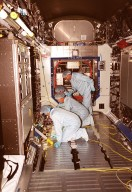 Members of the STS-98 crew check out equipment in the U.S. Lab Destiny during a Multi-Equipment Interface Test. During the mission, the crew will install the Lab in the International Space Station during a series of three space walks. The STS-98 mission will provide the station with science research facilities and expand its power, life support and control capabilities. The U.S. Laboratory Module continues a long tradition of microgravity materials research, first conducted by Skylab and later Shuttle and Spacelab missions. Destiny is expected to be a major feature in future research, providing facilities for biotechnology, fluid physics, combustion, and life sciences research. Making up the five-member crew on STS-98 are Commander Kenneth D. Cockrell, Pilot Mark L. Polansky, and Mission Specialists Robert L. Curbeam Jr., Thomas D. Jones (Ph.D.) and Marsha S. Ivins. The Lab is planned for launch aboard Space Shuttle Atlantis on the sixth ISS flight, currently targeted no earlier than Aug. 19, 2000