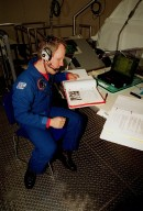 In the Space Station Processing Facility, STS-98 Mission Specialist Thomas D. Jones (Ph.D.) looks over documents as part of a Multi-Equipment Interface Test (MEIT) on the U.S. Lab Destiny. Other crew members taking part in the MEIT are Commander Kenneth D. Cockrell and Pilot Mark Polansky. The remaining members of the crew (not present for the MEIT) are and Mission Specialists Robert L. Curbeam Jr. and Marsha S. Ivins. During the STS-98 mission, the crew will install the Lab on the International Space Station during a series of three space walks. The mission will provide the station with science research facilities and expand its power, life support and control capabilities. The U.S. Laboratory Module continues a long tradition of microgravity materials research, first conducted by Skylab and later Shuttle and Spacelab missions. Destiny is expected to be a major feature in future research, providing facilities for biotechnology, fluid physics, combustion, and life sciences research. The Lab is planned for launch aboard Space Shuttle Atlantis on the sixth ISS flight, currently targeted no earlier than Aug. 19, 2000