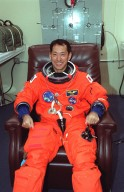 In the Operations and Checkout Building, STS-99 Mission Specialist Mamoru Mohri of Japan smiles as he dons his launch and entry suit during final launch preparations. Known as the Shuttle Radar Topography Mission (SRTM), STS-99 is scheduled for liftoff at 12:30 p.m. EST from Launch Pad 39A. The SRTM will chart a new course to produce unrivaled 3-D images of the Earth's surface. The result of the Shuttle Radar Topography Mission could be close to 1 trillion measurements of the Earth's topography. The mission is expected to last 11days, with Endeavour landing at KSC Tuesday, Feb. 22, at 4:36 p.m. EST. This is the 97th Shuttle flight and 14th for Shuttle Endeavour