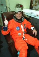 In the Operations and Checkout Building, a smiling STS-99 Commander Kevin Kregel gives a thumbs up for launch as he dons his launch and entry suit during final launch preparations. Known as the Shuttle Radar Topography Mission (SRTM), STS-99 is scheduled for liftoff at 12:30 p.m. EST from Launch Pad 39A. The SRTM will chart a new course to produce unrivaled 3-D images of the Earth's surface. The result of the Shuttle Radar Topography Mission could be close to 1 trillion measurements of the Earth's topography. The mission is expected to last 11days, with Endeavour landing at KSC Tuesday, Feb. 22, at 4:36 p.m. EST. This is the 97th Shuttle flight and 14th for Shuttle Endeavour