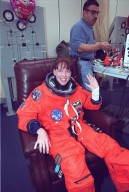 In the Operations and Checkout Building, a smiling STS-99 Mission Specialist Janet Kavandi waves after donning her launch and entry suit during final launch preparations. In background is a suit technician. STS-99, known as the Shuttle Radar Topography Mission (SRTM), is scheduled for liftoff at 12:30 p.m. EST from Launch Pad 39A. The SRTM will chart a new course to produce unrivaled 3-D images of the Earth's surface. The result of the Shuttle Radar Topography Mission could be close to 1 trillion measurements of the Earth's topography. The mission is expected to last 11days, with Endeavour landing at KSC Tuesday, Feb. 22, at 4:36 p.m. EST. This is the 97th Shuttle flight and 14th for Shuttle Endeavour