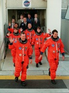 The STS-99 crew wave to onlookers as they step eagerly from the Operations and Checkout Building enroute to Launch Pad 39A for liftoff of Space Shuttle Endeavour. In their orange launch and entry suits, they are (foreground) Pilot Dominic Gorie and Commander Kevin Kregel. Behind them (left to right) are Mission Specialists Janice Voss, Mamoru Mohri of Japan, Gerhard Thiele of Germany and Janet Lynn Kavandi. Mohri is with the National Space Development Agency (NASDA) of Japan, and Thiele is with the European Space Agency. Known as the Shuttle Radar Topography Mission (SRTM), STS-99 is scheduled for liftoff at 12:30 p.m. EST. The SRTM will chart a new course to produce unrivaled 3-D images of the Earth's surface. The result of the Shuttle Radar Topography Mission could be close to 1 trillion measurements of the Earth's topography. The mission is expected to last 11days, with Endeavour landing at KSC Tuesday, Feb. 22, at 4:36 p.m. EST. This is the 97th Shuttle flight and 14th for Shuttle Endeavour