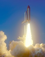 KENNEDY SPACE CENTER, Fla. -- A rainbow corona of light shimmers behind Space Shuttle Endeavour as a column of flame hurls it into space. Liftoff of the Shuttle on mission STS-99 occurred at 12:43:40 p.m. EST. Known as the Shuttle Radar Topography Mission (SRTM), STS-99 will chart a new course to produce unrivaled 3-D images of the Earth's surface. The result of the SRTM could be close to 1 trillion measurements of the Earth's topography. The mission is expected to last 11days, with Endeavour landing at KSC Tuesday, Feb. 22, at 4:36 p.m. EST. This is the 97th Shuttle flight and 14th for Shuttle Endeavour