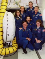 The STS-101 crew pose in the White Room outside Space Shuttle Atlantis behind them. In the front row are Pilot Scott Horowitz and Mission Specialists Yury Usachev and Susan Helms. In the back row are Mission Specialists Mary Ellen Weber and Jeffrey Williams, Commander James Halsell, and Mission Specialist James Voss. The crew are at KSC to take part in Terminal Countdown Demonstration Test (TCDT) activities that include emergency egress training from the orbiter and a dress rehearsal for launch. During their mission to the International Space Station, the STS-101 crew will be delivering logistics and supplies, plus preparing the Station for the arrival of the Zvezda Service Module, expected to be launched by Russia in July 2000. Also, the crew will conduct one space walk to perform maintenance on the Space Station. This will be the third assembly flight for the Space Station. STS-101 is scheduled to launch April 24 at 4:15 p.m. from Launch Pad 39A