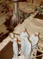 """KENNEDY SPACE CENTER, FLA. -- Members of the STS-92 crew pose for the photographer during a break from checking out Discovery's payload bay in the Orbiter Processing Facility bay 1. Their mission, the fourth U.S. flight to the ISS, includes as payload the Integrated Truss Structure Z1, an early exterior framework to allow the first U.S. solar arrays on a future flight to be temporarily installed on Unity for early power; Ku-band communication to support early science capability and U.S. television; and PMA-3 to provide a Shuttle docking port for solar array installation on the sixth ISS flight and Lab installation on the seventh ISS flight. The crew comprises Mission Commander Brian Duffy, Pilot Pamela Melroy, and Mission Specialists Koichi Wakata, Leroy Chiao, Peter """"Jeff"""" Wisoff, Michael Lopez-Alegria, and William McArthur. Launch of STS-92 is scheduled for Sept. 21, 2000. Wakata is with the National Space Development Agency of Japan"""