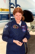 STS-101 Mission Specialist Susan Helms smiles on her arrival at KSC's Shuttle Landing Facility aboard the T-38 jet aircraft behind her. She and the rest of the crew are at KSC to get ready for their launch on April 24 about 4:15 p.m. EDT from Launch Pad 39A. The mission will take the crew to the International Space Station, delivering logistics and supplies, plus preparing the Station for the arrival of the Zvezda Service Module, expected to be launched by Russia in July 2000. Also, the crew will conduct one space walk to perform maintenance on the Space Station. This will be the third assembly flight for the Space Station