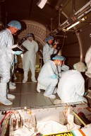 With workers looking on, STS-100 crew members check out equipment inside the Multi-Purpose Logistics Module Raffaello, located in the Space Station Processing Facility. Standing at center is Mission Specialist Umberto Guidoni, with the European Space Agency. Kneeling at right is Commander Kent Rominger. Mission STS-100, scheduled to launch April 19, 2001, will include Raffaello as well as the Space Station Remote Manipulator System (SSRMS) as its payload. MPLMs are pressurized modules that will serve as the International Space Station's ?moving vans,? carrying laboratory racks filled with equipment, experiments and supplies to and from the station aboard the Space Shuttle. The SSRMS is the primary means of transferring payloads between the orbiter payload bay and the International Space Station for assembly