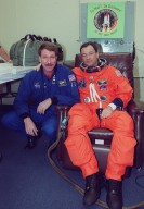 STS-92 Mission Specialist Michael E. Lopez-Alegria (right) is visited by astronaut Kent Rominger (left), who was recently named Commander of the STS-100 mission. Lopez-Alegria is getting suited up for launch on mission STS-92, scheduled for 8:05 p.m. EDT. The mission is the fifth flight for the construction of the ISS. The payload includes the Integrated Truss Structure Z-1 and the third Pressurized Mating Adapter. During the 11-day mission, four extravehicular activities (EVAs), or spacewalks, are planned. The Z-1 truss is the first of 10 that will become the backbone of the International Space Station, eventually stretching the length of a football field. PMA-3 will provide a Shuttle docking port for solar array installation on the sixth ISS flight and Lab installation on the seventh ISS flight. This launch is the second for Lopez-Alegria. Landing is expected Oct. 21 at 3:55 p.m. EDT