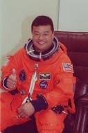 STS-92 Mission Specialist Leroy Chiao signals thumbs up for launch, scheduled for 8:05 p.m. EDT. The mission is the fifth flight for the construction of the ISS. The payload includes the Integrated Truss Structure Z-1 and the third Pressurized Mating Adapter. During the 11-day mission, four extravehicular activities (EVAs), or spacewalks, are planned. The Z-1 truss is the first of 10 that will become the backbone of the International Space Station, eventually stretching the length of a football field. PMA-3 will provide a Shuttle docking port for solar array installation on the sixth ISS flight and Lab installation on the seventh ISS flight. This launch is the third for Chiao. Landing is expected Oct. 21 at 3:55 p.m. EDT