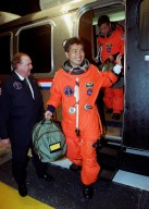 STS-92 Mission Specialist Koichi Wakata of Japan exits the Astrovan on its return to the Operations and Checkout Building. Behind him is Mission Specialist Leroy Chiao. The scheduled launch to the International Space Station (ISS) was scrubbed about 90 minutes before liftoff. The mission will be the fifth flight for the construction of the ISS. The payload includes the Integrated Truss Structure Z-1 and the third Pressurized Mating Adapter. During the 11-day mission, four extravehicular activities (EVAs), or spacewalks, are planned. The Z-1 truss is the first of 10 that will become the backbone of the International Space Station, eventually stretching the length of a football field. PMA-3 will provide a Shuttle docking port for solar array installation on the sixth ISS flight and Lab installation on the seventh ISS flight. The launch has been rescheduled for liftoff Oct. 11 at 7:17 p.m