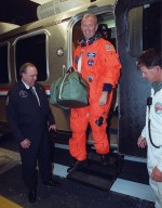 STS-92 Commander Brian Duffy pauses in the door of the Astrovan before exiting at the Operations and Checkout Building. The vehicle is returning the crew after the scheduled launch to the International Space Station (ISS) was scrubbed about 90 minutes before liftoff. The mission will be the fifth flight for the construction of the ISS. The payload includes the Integrated Truss Structure Z-1 and the third Pressurized Mating Adapter. During the 11-day mission, four extravehicular activities (EVAs), or spacewalks, are planned. The Z-1 truss is the first of 10 that will become the backbone of the International Space Station, eventually stretching the length of a football field. PMA-3 will provide a Shuttle docking port for solar array installation on the sixth ISS flight and Lab installation on the seventh ISS flight. The launch has been rescheduled for liftoff Oct. 11 at 7:17 p.m