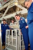 On the 195-foot level at Launch Pad 39B, the STS-97 crew watch the action of the slidewire basket during emergency egress training. At left is Pilot Mike Bloomfield; on the right are Mission Specialists Joe Tanner and Marc Garneau. The training is part of Terminal Countdown Demonstration Test (TCDT) activities, which also include a simulated launch countdown and opportunities to inspect the mission payloads in the orbiter?s payload bay. Mission STS-97is the sixth construction flight to the International Space Station. Its payload includes the P6 Integrated Truss Structure and a photovoltaic (PV) module, with giant solar arrays that will provide power to the Station. The mission includes two spacewalks to complete the solar array connections. STS-97 is scheduled to launch Nov. 30 at 10:05 p.m. EST