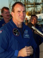 After arriving at the Shuttle Landing Facility, the STS-97 crew gather to address the media. At the microphone is Pilot Michael Bloomfield. Behind him can be seen Mission Specialists Joseph Tanner and Carlos Noriega. Mission STS-97 is the sixth construction flight to the International Space Station. Its payload includes the P6 Integrated Truss Structure and a photovoltaic (PV) module, with giant solar arrays that will provide power to the Station. The mission includes two spacewalks to complete the solar array connections. STS-97 is scheduled to launch Nov. 30 at about 10:06 p.m. EST