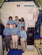 KENNEDY SPACE CENTER, Fla. -- Taking part in In-Flight Maintenance training, the STS-107 crew poses in front of the SPACEHAB Double Module. In back are Mission Specialist Laurel Clark, Payload Specialist Ilan Ramon of Israel and Mission Specialist Kalpana Chawla; in front are Mission Specialist David M. Brown, Commander Rick D. Husband, Pilot William C. ?Willie? McCool (behind) and Mission Specialist Michael Anderson. As a research mission, STS-107 will carry the SPACEHAB Double Module in its first research flight into space and a broad collection of experiments ranging from material science to life science. It is scheduled to launch July 19, 2001