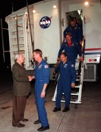 KENNEDY SPACE CENTER, FLA. -- Following a successful landing, the crew of Endeavour exit the Crew Transport Vehicle and are greeted by NASA Administrator Daniel Goldin. First down the stairs is Commander Brent Jett. Behind him are Pilot Michael Bloomfield and Mission Specialists Joseph Tanner, Marc Garneau and Carlos Noriega. Garneau is with the Canadian Space Agency. On the 4.4-million-mile mission, Endeavour carried the P6 Integrated Truss Structure with solar arrays to power the International Space Station. The arrays and other equipment were installed during three EVAs that totaled 19 hours, 20 minutes. Endeavour was docked with the Space Station for 6 days, 23 hours, 13 minutes. This is the 16th nighttime landing for a Space Shuttle and the 53rd at Kennedy Space Center