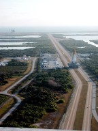 KENNEDY SPACE CENTER, Fla. -- Photographed from the top of the Vehicle Assembly Building, Space Shuttle Atlantis creeps along the crawlerway for the trek to Launch Pad 39A (upper left). In the background is the Atlantic Ocean. The Shuttle has been in the VAB undergoing tests on the solid rocket booster cables. A prior extensive evaluation of NASA?s SRB cable inventory on the shelf revealed conductor damage in four (of about 200) cables. Shuttle managers decided to prove the integrity of the system tunnel cables already on Atlantis, causing return of the Shuttle to the VAB a week ago. Launch of Atlantis on STS-98 has been rescheduled to Feb. 7 at 6:11 p.m. EST