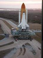KENNEDY SPACE CENTER, Fla. -- In the early morning light, Space Shuttle Atlantis makes the turn from the Vehicle Assembly Building onto the crawlerway for the trek to Launch Pad 39A. The Shuttle has been in the VAB undergoing tests on the solid rocket booster cables. A prior extensive evaluation of NASA?s SRB cable inventory on the shelf revealed conductor damage in four (of about 200) cables. Shuttle managers decided to prove the integrity of the system tunnel cables already on Atlantis, causing return of the Shuttle to the VAB a week ago. Launch of Atlantis on STS-98 has been rescheduled to Feb. 7 at 6:11 p.m. EST