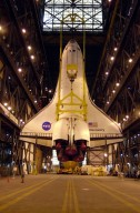 The orbiter Discovery is finally vertical and hangs suspended in the transfer aisle of the Vehicle Assembly Building. It will next be moved into high bay 1 for mating with its solid rocket boosters and external tank. Discovery will be launched March 8 on mission STS-102, the eighth construction flight to the International Space Station. The Shuttle will carry the Multi-Purpose Logistics Module Leonardo, the first of three pressurized modules provided by the Italian Space Agency to carry supplies and equipment to the Space Station and back to earth
