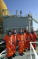 At the 215-foot level of the Fixed Service Structure, Launch Pad 39B, the STS-102 crew pose for a photograph. Standing, left to right, are Mission Specialist Susan Helms; Pilot James Kelly; Mission Specialists Andrew Thomas and Paul Richards; Commander James Wetherbee; and Mission Specialists Yury Usachev and James Voss. Voss, Helms and Usachev are the Expedition Two crew going to the International Space Station for their four-month rotation. Expedition One will return to Earth with Discovery. STS-102 is the eighth construction flight to the Space Station, with Space Shuttle Discovery carrying the Multi-Purpose Logistics Module Leonardo. Launch on mission STS-102 is scheduled for March 8