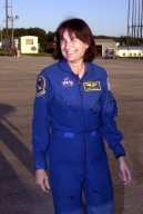 KENNEDY SPACE CENTER, Fla. -- STS-108 Mission Specialist Linda A. Godwin pauses after her arrival at KSC. She and the rest of the crew will be preparing for launch Nov. 29 on Space Shuttle Endeavour. Liftoff is scheduled for 7:41 p.m. EST. Top priorities for the STS-108 (UF-1) mission of Endeavour are rotation of the International Space Station Expedition Three and Expedition Four crews, bringing water, equipment and supplies to the station in the Multi-Purpose Logistics Module Raffaello, and completion of spacewalk and robotics tasks. Mission Specialists Daniel M. Tani and Godwin will take part in the spacewalk to install thermal blankets over two pieces of equipment at the bases of the Space Station's solar wings. Other crew members are Commander Dominic L. Gorie and Pilot Mark E. Kelly