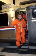 KENNEDY SPACE CENTER, Fla. -- Expedition 4 Commander Yuri Onufrienko steps down from the Astrovan after returning from Space Shuttle Endeavour. The launch of STS-108 was delayed by one day Dec. 4, 2001, due to poor weather at Kennedy. Space Shuttle Endeavour is now scheduled to lift off at 5:19 p.m. EST (2219 GMT) Dec. 5