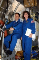 KENNEDY SPACE CENTER, FLA. -- At SPACEHAB in Cape Canaveral, Fla., STS-107 Mission Specialists Ilan Ramon of Israel and Laurel Clark check out the equipment for the mission. STS-107 is a research mission, and the primary payload is the first flight of the SHI Research Double Module (SHI/RDM). The experiments range from material sciences to life sciences (many rats). Among the experiments is a Hitchhiker carrier system, modular and expandable in accordance with payload requirements. STS-107 is scheduled to launch in June 2002