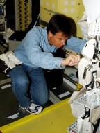 KENNEDY SPACE CENTER, FLA. - STS-107 Payload Specialist Ilan Ramon checks equipment during crew training at SPACEHAB, Cape Canaveral, Fla. STS-107 is a research mission, and the primary payload is the first flight of the SHI Research Double Module (SHI/RDM). The experiments range from material sciences to life sciences (many rats). Among the experiments is a Hitchhiker carrier system, modular and expandable in accordance with payload requirements. STS-107 is scheduled to launch in June 2002.