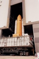 KENNEDY SPACE CENTER, FLA. -- Seen from outside, Space Shuttle Atlantis moves back inside the Vehicle Assembly Building after an aborted rollout to Launch Pad 39A. Atlantis will fly on mission STS-98, the seventh construction flight to the International Space Station. The orbiter will carry in its payload bay the U.S. Laboratory, named Destiny, that will have five system racks already installed inside the module. After delivery of electronics in the lab, electrically powered attitude control for Control Moment Gyroscopes will be activated. Atlantis is scheduled for launch no earlier than Jan. 19, 2001, with a crew of five