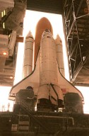 KENNEDY SPACE CENTER, FLA. -- Viewed from inside the Vehicle Assembly Building, Space Shuttle Atlantis moves back inside after an aborted rollout to Launch Pad 39A. Atlantis will fly on mission STS-98, the seventh construction flight to the International Space Station. The orbiter will carry in its payload bay the U.S. Laboratory, named Destiny, that will have five system racks already installed inside the module. After delivery of electronics in the lab, electrically powered attitude control for Control Moment Gyroscopes will be activated. Atlantis is scheduled for launch no earlier than Jan. 19, 2001, with a crew of five