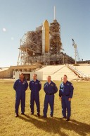KENNEDY SPACE CENTER, FLA. -- Four members of the STS-98 crew pose for a photo at Launch Pad 39A. Standing, left to right, are Mission Specialist Robert Curbeam, Pilot Mark Polansky, Commander Ken Cockrell and Mission Specialist Thomas Jones. Not pictured is Mission Specialist Marsha Ivins. The crew is at KSC to take part in Terminal Countdown Demonstration Test activities, which include emergency egress training and a simulated launch countdown. STS-98 is the seventh construction flight to the International Space Station, carrying as payload the U.S. Lab Destiny, a key element in the construction of the ISS. Launch of STS-98 is scheduled for Jan. 19 at 2:11 a.m