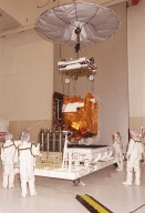 In the Spacecraft Assembly & Encapsulation Facility -2, the 2001 Mars Odyssey Orbiter [ http://mars.jpl.nasa.gov/2001/ ]is lifted from a platform by an overhead crane while workers help guide it. The Odyssey is being moved to a workstand in the SAEF-2. The spacecraft carries three science instruments: the Thermal Emission Imaging System (THEMIS), the Gamma Ray Spectrometer (GRS), and the Mars Radiation Environment Experiment (MARIE). THEMIS will map the mineralogy and morphology of the Martian surface using a high-resolution camera and a thermal infrared imaging spectrometer. The GRS will achieve global mapping of the elemental composition of the surface and determine the abundance of hydrogen in the shallow subsurface. [The GRS is a rebuild of the instrument lost with the Mars Observer mission.] The MARIE will characterize aspects of the near-space radiation environment as related to the radiation-related risk to human explorers. The Mars Odyssey Orbiter is scheduled for launch on April 7, 2001, aboard a Delta 7925 rocket from Launch Pad 17-A, Cape Canaveral Air Force Station