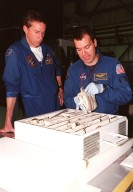 STS-102 Commander James D. Wetherbee watches as Mission Specialist Paul W. Richards handles some of the equipment inside the tool caddy that is carried on launches. The mission crew is at KSC for Crew Equipment Interface Test activities. STS-102 is the 8th construction flight to the International Space Station and will carry the Multi-Purpose Logistics Module Leonardo. STS-102 is scheduled for launch March 1, 2001. On that flight, Leonardo will be filled with equipment and supplies to outfit the U.S. laboratory module Destiny. The mission will also be carrying the Expedition Two crew to the Space Station, replacing the Expedition One crew who will return on Shuttle Discovery