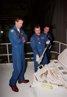 In the Orbiter Processing Facility bay 1, STS-102 crew members check out tools in the tool caddy that is carried on launches. From left is Commander James D. Wetherbee, Mission Specialist Paul W. Richards and Pilot James W. Kelly. The mission crew is at KSC for Crew Equipment Interface Test activities