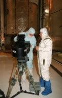 In the Payload Changeout Room at Launch Pad 39A, a film crew from IMAX prepares its 3-D movie camera to film the payload bay door closure on Atlantis. Behind them is the payload, the U.S. Laboratory Destiny, which will fly on mission STS-98, the seventh construction flight to the ISS. Destiny, a key element in the construction of the International Space Station, is 28 feet long and weighs 16 tons. This research and command-and-control center is the most sophisticated and versatile space laboratory ever built. It will ultimately house a total of 23 experiment racks for crew support and scientific research. Launch of Atlantis is Feb. 7 at 6:11 p.m. EST