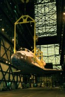 The orbiter Discovery is lifted by cranes in the transfer aisle of the Vehicle Assembly Building. It will next be lifted into a vertical position and into high bay 1 for mating with its solid rocket boosters and external tank. Discovery will be launched March 8 on mission STS-102, the eighth construction flight to the International Space Station. The Shuttle will carry the Multi-Purpose Logistics Module Leonardo, the first of three pressurized modules provided by the Italian Space Agency to carry supplies and equipment to the Space Station and back to Earth