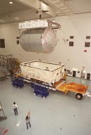 In the Space Station Processing Facility, workers help guide the overhead crane as it lifts the Multi-Purpose Logistics Module Donatello out of the shipping container. In the SSPF, Donatello will undergo processing by the payload test team, including integrated electrical tests with other Station elements in the SSPF, leak tests, electrical and software compatibility tests with the Space Shuttle (using the Cargo Integrated Test equipment) and an Interface Verification Test once the module is installed in the Space Shuttle?s payload bay at the launch pad. The most significant mechanical task to be performed on Donatello in the SSPF is the installation and outfitting of the racks for carrying the various experiments and cargo. Donatello will be launched on mission STS-130, currently planned for September 2004