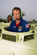 STS-102 Mission Specialist Andrew Thomas drives an M-113 armored carrier as part of emergency egress training. With him is (left) Capt. George Hoggard, a training officer with SGS Fire Services, and other crew members Commander James Wetherbee, Pilot James Kelly and Mission Specialist Paul Richards (seen behind Thomas, at right). The M-113, in the event of an emergency at the pad prior to launch, could be used to transport the crew to a nearby bunker or farther. The STS-102 crew is at KSC to take part in Terminal Countdown Demonstration Test activities, which also include a simulated launch countdown. STS-102 is the eighth construction flight to the International Space Station, carrying as payload the Multi-Purpose Logistics Module Leonardo. Launch on mission STS-102 is scheduled for March 8