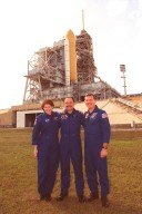 At the slidewire basket landing near Launch Pad 39B, the Expedition Two crew poses for a photograph. From left to right are Susan Helms, Yury Usachev and James Voss. They are flying on Space Shuttle Discovery (seen in the background) as mission specialists for STS-102, joining Commander James Wetherbee, Pilot James Kelly and Mission Specialists Andrew Thomas and Paul Richards for the eighth construction flight to the International Space Station. Voss, Helms and Usachev will be replacing the Expedition One crew, who will return to Earth with Discovery. STS-102 will be carrying the Multi-Purpose Logistics Module Leonardo. Launch on mission STS-102 is scheduled for March 8