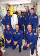 The STS-102 crew poses in the White Room outside the orbiter Discovery on Launch Pad 39B. Kneeling in front are Mission Specialists Susan Helms, Yury Usachev and James Voss. Standing behind them are Mission Specialists Paul Richards and Andrew Thomas, Commander James Wetherbee and Pilot James Kelly. The crew is taking part in Terminal Countdown Demonstration Test activities, which include emergency exit training and a simulated launch countdown. STS-102 is the eighth construction flight to the International Space Station, with Space Shuttle Discovery carrying the Multi-Purpose Logistics Module Leonardo. Voss, Helms and Usachev are the Expedition Two crew who will be the second resident crew on the International Space Station. They will replace Expedition One, who will return to Earth with Discovery. Launch on mission STS-102 is scheduled for March 8