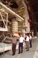 A distinguished group look at the solid rocket booster in the Vehicle Assembly Building. Starting second from left are Gen. Ralph Everhart, Commander, Space Command; Center Director Roy Bridges, Dave King, director of Shuttle Processing, and Brig. Gen. Donald Pettit, Commander of the 45th Space Wing, Cape Canaveral