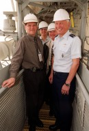 After the rollout of Space Shuttle Discovery, Brig. Gen. Donald Pettit (2nd from left), Center Director Roy Bridges, and Gen. Ralph Everhart take a look at the Fixed Service Structure on Launch Pad 39B. At far left is Dave Rainer. Gen. Everhart is Commander of the Space Command and Gen. Pettit is Commander of the 45th Space Wing, Cape Canaveral