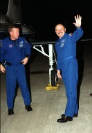 After landing at KSC?s Shuttle Landing Facility, Russian cosmonaut and STS-102 Mission Specialist Yury Usachev (right) waves to the media. Pilot James Kelly (left) is ready to join the other crew members at the microphone. The crew comprises Commander James Wetherbee, Kelly, and Mission Specialists Andrew Thomas, Paul Richards, James Voss, Susan Helms and Usachev. Helms, Usachev and Voss are also the Expedition Two crew replacing Expedition One on the International Space Station. STS-102 will be carrying the Multi-Purpose Logistics Module Leonardo, the primary delivery system used to resupply and return Station cargo requiring a pressurized environment. Leonardo will deliver up to 10 tons of laboratory racks filled with equipment, experiments and supplies for outfitting the newly installed U.S. Laboratory Destiny. STS-102 is scheduled to launch March 8 at 6:42 a.m. EST