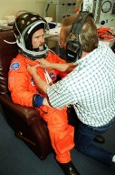 In the Operations and Checkout Building, STS-100 Mission Specialist Chris Hadfield gets his launch suit adjusted by a suit technician. Hadfield and the rest of the crew Commander Kent V. Rominger, Pilot Jeffrey S. Ashby and Mission Specialists Scott E. Parazynski, John L. Phillips, Umberto Guidoni and Yuri Lonchakov are taking part in Terminal Countdown Demonstration Test activities, from emergency escape training at the pad to a simulated launch countdown. An international crew, Hadfield is with the Canadian Space Agency, Guidoni the European Space Agency and Lonchakov the Russian Aviation and Space Agency. The mission is carrying the Multi-Purpose Logistics Module Raffaello and the Canadian robotic arm, SSRMS, to the International Space Station. Raffaello carries six system racks and two storage racks for the U.S. Lab. The SSRMS is crucial to the continued assembly of the orbiting complex and has a unique ability to switch ends as it works, ?inchworming? along the Station?s exterior. Launch of mission STS-100 is scheduled for April 19 at 2:41 p.m. EDT from Launch Pad 39A
