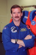 STS-100 Mission Specialist Chris Hadfield pauses for the camera during Terminal Countdown Demonstration Test activities that include emergency escape training at the pad and a simulated launch countdown. The mission is carrying the Multi-Purpose Logistics Module Raffaello and the Canadian robotic arm, SSRMS, to the International Space Station. Raffaello carries six system racks and two storage racks for the U.S. Lab. The SSRMS is crucial to the continued assembly of the orbiting complex. Launch of mission STS-100 is scheduled for April 19 at 2:41 p.m. EDT from Launch Pad 39A