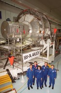 KENNEDY SPACE CENTER, FLA. -- The STS-104 crew poses in front of the Joint Airlock Module in the Space Station Processing Facility. Standing, left to right, are Pilot Charles Hobaugh, Mission Specialists James Reillly, Janet Kavandi and Michael Gernhardt, and Commander Steven Lindsey. They are at KSC to continue Crew Equipment Interface Test activities such as payload familiarization. The airlock is the primary payload on their mission, scheduled to launch no earlier than June 14, 2001, from Launch Pad 39B