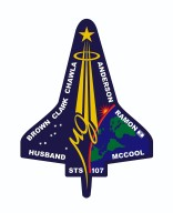JOHNSON SPACE CENTER, HOUSON, TEXAS -- STS-107 INSIGNIA -- This is the insignia for STS-107, which is a multi-discipline microgravity and Earth science research mission with a multitude of international scientific investigations conducted continuously during the planned 16 days on orbit. The central element of the patch is the microgravity symbol flowing into the rays of the astronaut symbol. The mission inclination is portrayed by the 39-degree angle of the astronaut symbol to the Earth's horizon. The sunrise is representative of the numerous experiments that are the dawn of a new era for continued microgravity research on the International Space Station and beyond. The breadth of science conducted on this mission will have widespread benefits to life on Earth and our continued exploration of space, illustrated by the Earth and stars. The constellation Columba (the dove) was chosen to symbolize peace on Earth and the Space Shuttle Columbia. The seven stars also represent the mission crew members and honor the original astronauts who paved the way to make research in space possible. The Israeli flag is adjacent to the name of the payload specialist who is the first person from that country to fly on the Space Shuttle. The NASA insignia design for Space Shuttle flights is reserved for use by the astronauts and for other official use as the NASA Administrator may authorize. Public availability has been approved only in the form of illustrations by the various news media. When and if there is any change in this policy, which we do not anticipate, it will be publicly announced.